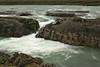 Skjálfandafljót River - being rechanneled above the Goðafoss (waterfall) amongst the eroded volcanic rock - where it forms a river island below.