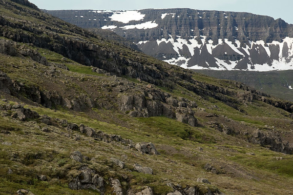 Across the northern slope of the Þverfell (mountain) - to the snow banks along  the craggy slopes of the Kambfell (mountain).