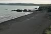 Magnavík (cove), displaying is black volcanic sand beach during the beginning of flood tide - along the Öxarfjðrður (fjord) - and distal the Leirhafnarfjöll (mountains) along the Melrakkaslétta Peninsula.