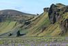 Hjörleifshöfði (headland) - with a patch of nootka lupine below,  here in the Mýrdalssandur glacial outwash plain.