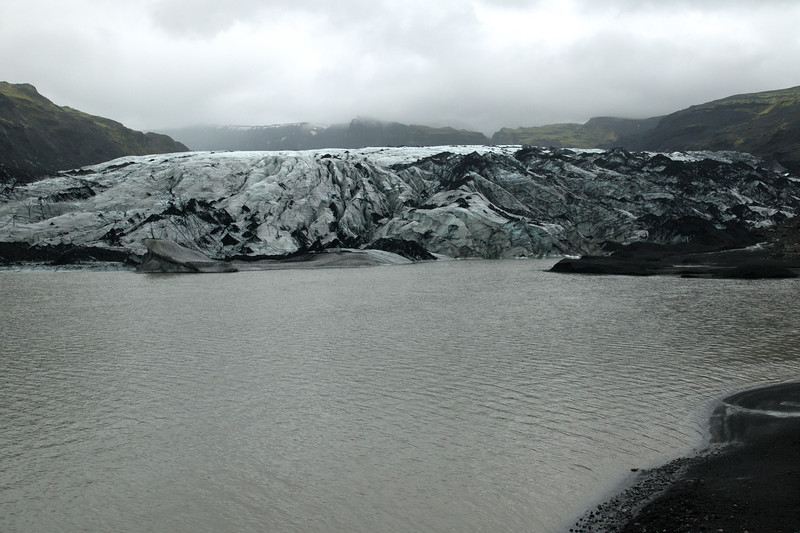Sólheimajökull - an outlet glacier from the Mýrdalsjökull, the 4th largest ice cap in Iceland, measuring about 214 mi² (555 km²) in 2010, with some glacial ablation since - technically an ice cap is a dome-shaped mass of glaciar ice that spread out in all directions, whose ice area is < 19,300 mi² (50,000 km²).