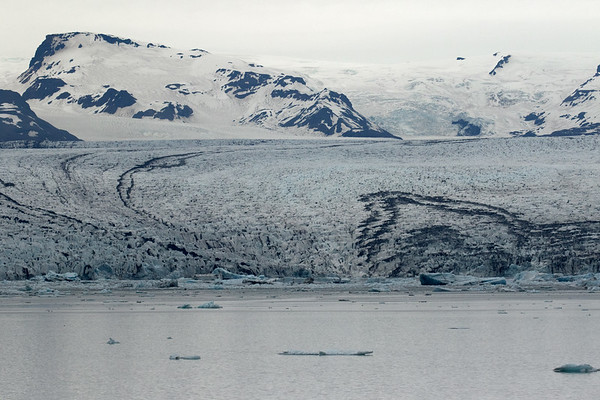 Jökulsárlón (Glacier River Lagoon) - adjacent the calving glacier of the Breiðamerkurjökull (glacier) - and beyond the nunatak (glacial rock island), known as the Esjufjöll (mountains).
