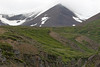 Up the slopes of the Karlsárdalur (valley) - to the snow banks and clouds upon the slope and ridge of the Litlihnjukúr - Northeastern region of Iceland,.