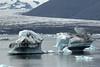Glacial ice afloat the Jökulsárlón (lagoon) - Breiðamerkurjökull (glacier) - lower slope and western end of the Veðhurárdalsegg (ridge) - distal the Esjufjöll (mountains).