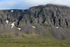 Krossavíkurfjöll (mountains) - along its steep eroded scree slope and glacial sculpted igneous rock cliff.