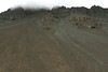 Up the volcanic scree slope along the Hafjall (mountain) - with the clouds amongst the jagged volcanic rock ridge.