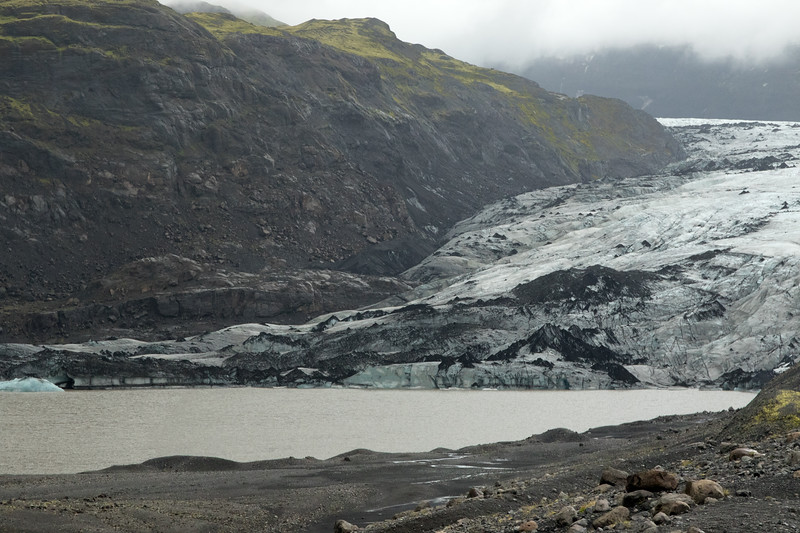 Glacier - where the accumulation of snow and ice exceeds ablation (loss of snow and ice due to vaporization, melting, calving, etc.), and technically must be at least about 25 acres (10 hectares) in area, and around 165 ft. (50 m) thick - here the Sólheimajökull (glacier) - in the Katla Geopark - Southern region of Iceland.