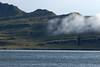 Spararfjall (mountain), along its lower southeastern area, amongst the drifting cloud - along the Fáskrúdsfjörður (fjord).