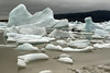 Calved icebergs, bergy bits, and growlers afloat the Fjallssárlón (Mountain Lagoon).