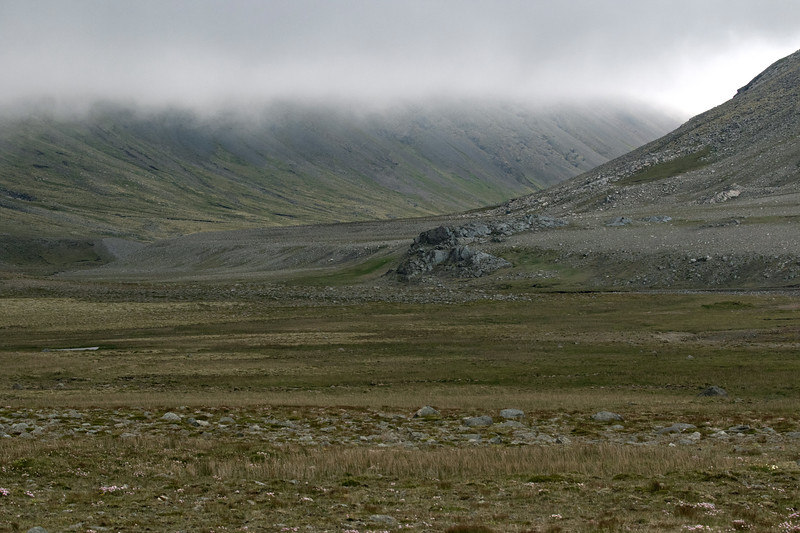 Southern slope of the Krossanesfjall (Cross Mountain) - beyond amongst the clouds to the slope of the Hvalnesfjall (Whale Mountain).