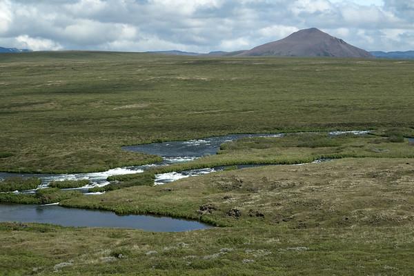 Laxá (river) - distal to the peak of the Vindbelgjarfjall (mountain), rising to around 1,720 ft. (524 m), - Eastern region of Iceland.