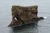 Volcanic rock sea stack/arch upon the Vopnafjörður (fjord) - Eastern region of Iceland.