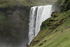Skógafoss - cresting about 80 ft. (24 m) across the volcanic rock ledge - with the water glacial water from the Eyjafjallajökull and Mýrdalsjökull (ice caps) - Southern region of Iceland.