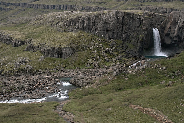 Folaldafoss (Foal Falls) - sourced by the Berufjarðará (river) - along the volcanic rock ledge of the Fossárfell (mountain) - located along the northwestern end of the Berujörður (fjord) - Eastern region.