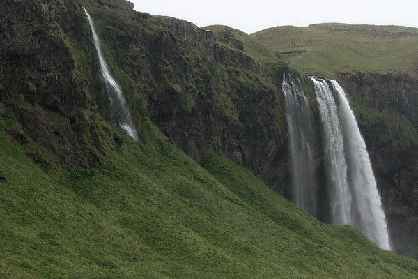 Seljalandsfoss in the distance - plunging  about 200 ft. (60 m) - late June.