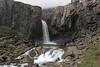 Berufjarðará (river) - Folaldafoss (Foal Falls) - distal slope of the Fossárfell (mountain) among the clouds.