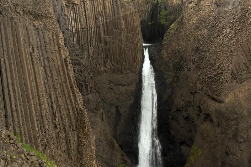 Litlanesfoss or Stuðlabergsfoss (Basalt Column Falls) - framed by the columnar basalt rock - along the Hengifossá (river).