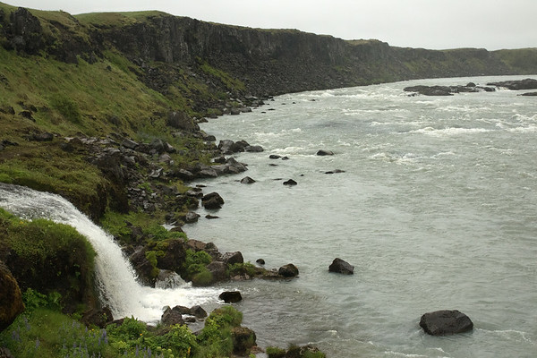 Waterfalls sourced by the Kampholtskeldá (river) - flowing into the Þjórsá (river), just above the Urriðafoss (waterfall) - amongst the mid afternoon overcast sky, during the early summer season - Southern region of Iceland (1 of 8 geographical regions).