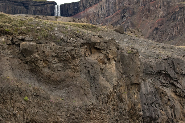 Distal beyond the the volcanic basalt rock cliff - to the Hengifoss (falls) cresting the volcanic rock ledge.