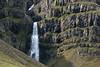 Hrútá (river) Falls - cascading along the eroded volcanic rock,  along the southwestern area of the Reydarfjörður (fjord).