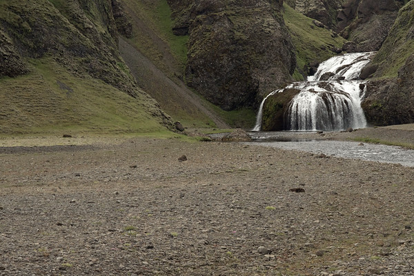 Beyond the scattered lithophytic vegetation upon the volcanic rock - to the Stjórn (stream), and beyond the 2-tier cascading falls of Stjórnarfoss.