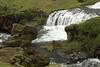 Hestavadsfoss - lower cascade, among the volcanic rock, moss, lichen, grass, and shrub.