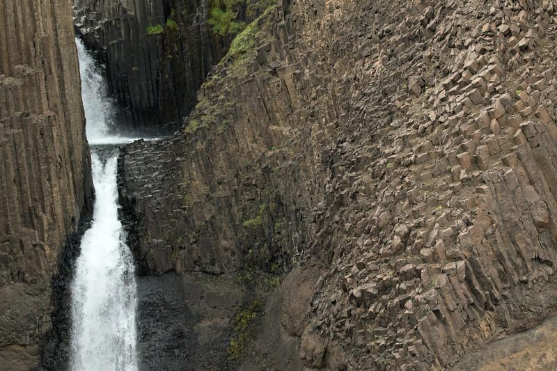 Litlanesfoss or Stuðlabergsfoss (Basalt Column Falls) - a two-tier or cascade falls (seen here), among he columnar volcanic basalt rock and lithophytic vegetation.