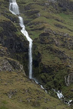 Cascading falls flowing along the slope of the Maelifell (mountain) - Snæfellsnes (peninsula) - along the huge Breidafjörður (fjord/bay).