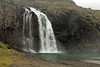 Falls flowing from the volcanic rock ledge at the southern end of the Fossfjörður (Waterfall Fjord) - sourced by the Fossá (river) - along the northwest slope of the Skardsfell (mountain) - Westfjords region of Iceland.