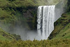 Skógafoss - plunging about 200 ft. (60 m), with a crest width of around 80 ft. (24 m) - Southern region of  Iceland.