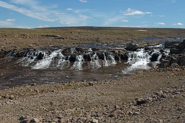 Falls along the slope of the Margrétarfell (mountain) - flowing northward towards the Isafjörður (fjord) - Westfjords region of Iceland.