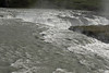Urridafoss - across the glacial water rapids, to its crest along the Thjorsá (river).