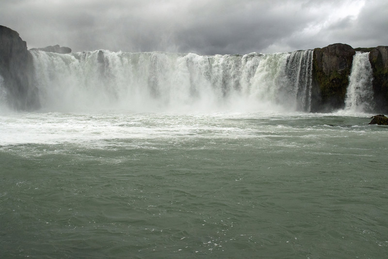 Goðafoss (Waterfall of the Gods) - with the mist of the Skjálfandafljót (river), fusing with the low-lying and thick clouds Cumulus above.