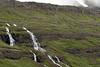 Cascading falls along the lower slope of Strandarfjall (mountain) - Eastern region of Iceland.