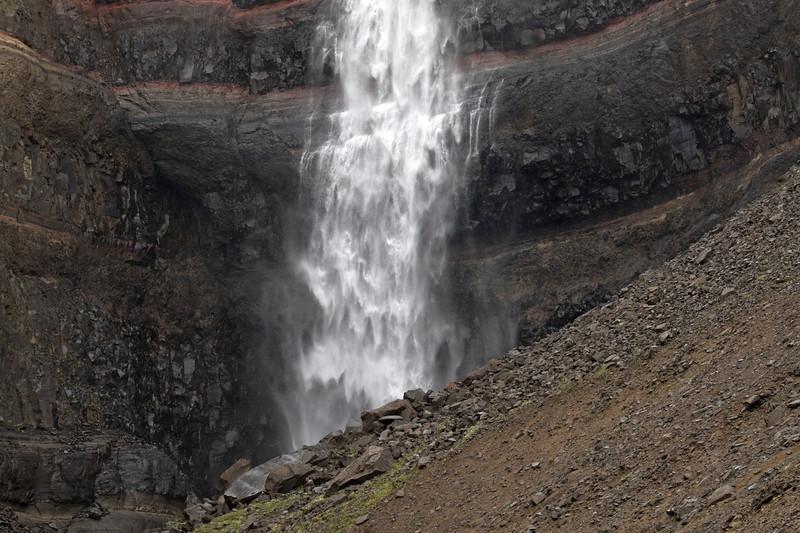 Beyond the volcanic basalt talus boulders to the Hengifoss (falls).