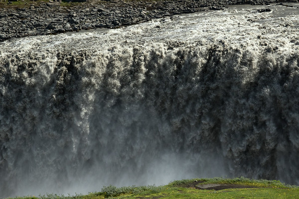Dettifoss - this falls is one of, if not, the most powerful in Europe - flowing at around 9,500 ft³/sec (269 m³/sec) during the summer months, but can peak at higher volumes - located in the Vatnajökull National Park - this image in early July, during the wettest and coldest summer season (2018) in more than a century in Iceland - helping to further produce river waterflow rates well above normal throughout this island country, which has such an uniquely extreme density of waterfalls (of significant heights and flow rates) confined to such a small area of landmass, that is assembled on our Planet.