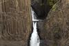Litlanesfoss or Stuðlabergsfoss (Basalt Column Falls) - framed with the  jointed columns of igneous basalt rock - along the Hengifossá (river).
