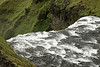Skógafoss - across its crest, and amongst the volcanic rock, moss, lichens, grass and seabirds.