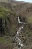 Up the Hengifossá (river) to a falls along the volcanic basalt rock canyon.