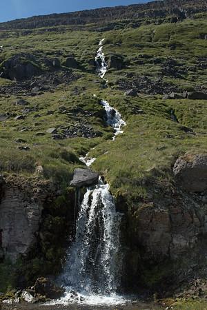 Cascade falls along the Seljalækur (stream) - along the SW slopes of the Skotufjörður (fjord).
