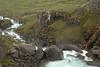 Fardagafoss - Fjarðará (Fjord River) - igneous basalt rock among the moss, lichen, and grass.