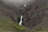 Cascading falls sourced by the Vatnsdalsjökull (glacier) - along the Gilsgil (gorge) - between the Gilshnjúkur and Varmavatnshólahnjúkur (headland or promontory) - Northeastern region of Iceland.