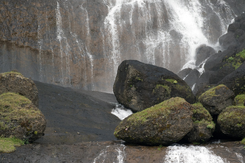 Volcanic rock scree boulders among the Siðufoss, the horsetail section of this falls - along the Seldalur (valley) - Southern region of Iceland.