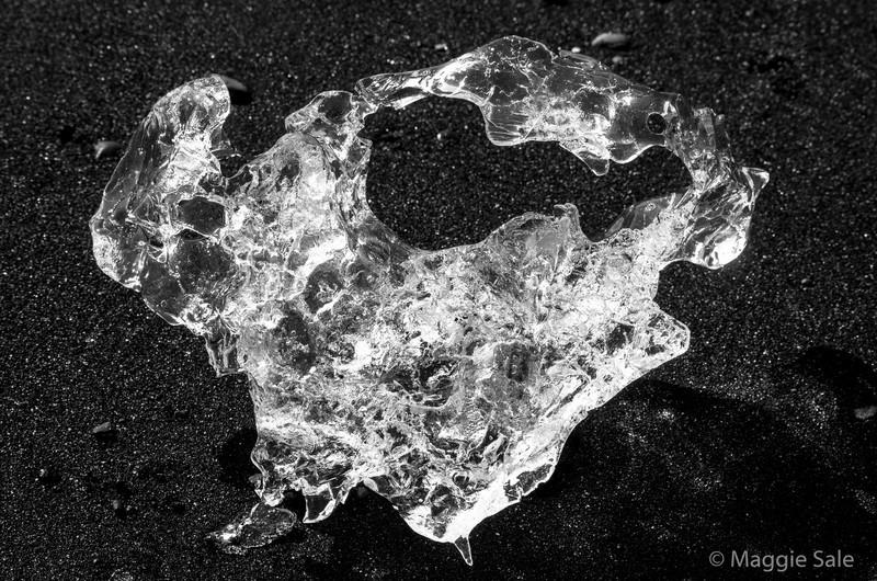 Melting ice on lava beach near Jokulsarlon