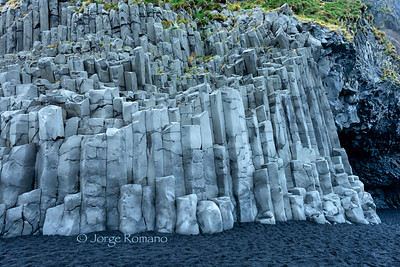 Famous basalt columns and black sand at Reynisfjara Beach in Southern Iceland