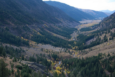 At view down canyon from the climbing pullout.  The old grade is visible crossing through the large grove of aspens.