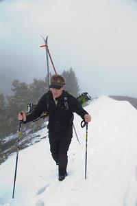 Greg walks the wind drift towards pt 8575.