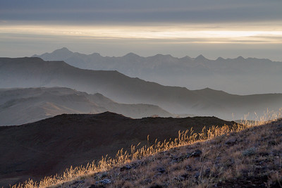 Jerry Peak Wilderness, Boulder White Cloud Mountains - The Lost River Mountains provide a backdrop for a fall sunrise slashes across the arid landscape near the summit of Herd Creek.