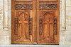 Carved wooden doors at the stone portal of the Iglesia Saraguro - Loya province.