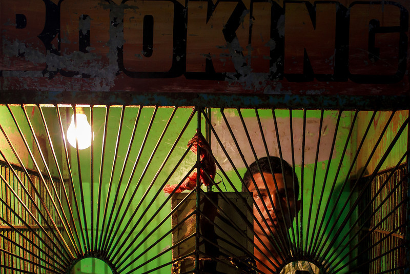 The Booking Agent: Caught manning a ticket booth at a Durga Puja fairground